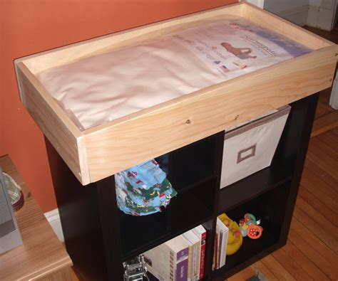 baby changing tray that fits on top of a bookshelf 3