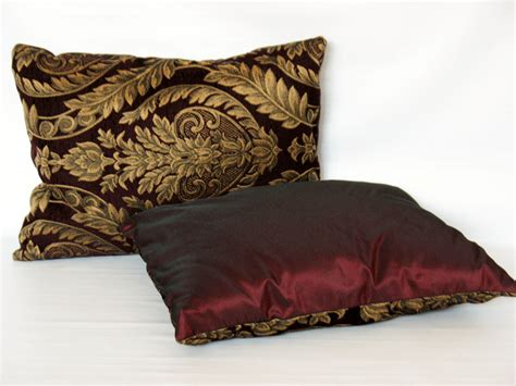 Burgundy Pillows Decorative by Gold And Burgundy Decorative Pillow With Classic Leaf And