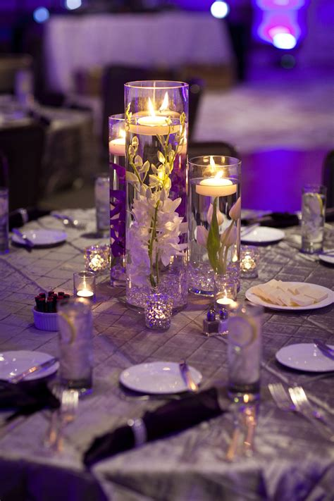 Wedding Season Supplies Wedding Ideas Candle The Roses Pillar submerged flower centerpiece simple centerpiece floating candles orchids tulips florals by