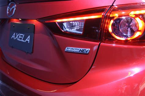 does toyota own mazda 2013 tokyo auto show live mazda3 hybrid and cng
