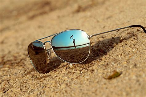 sunglasses on the reflection scenery most