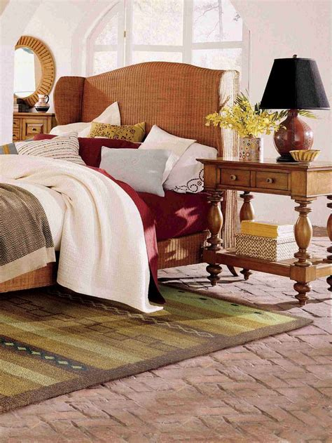 rugs for under bed layer your bedding for a welcoming feel an area rug under