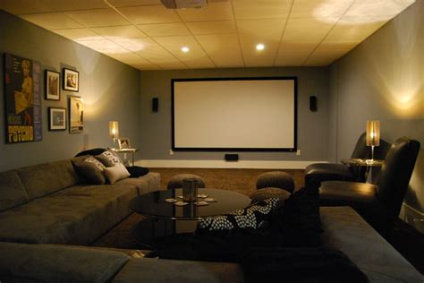 basement media room with sectional sofa and giraffe texture carpeting modern home theater