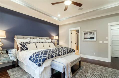 Superior Black And Gold Living Room Furniture #4: Light-gray-bedroom-with-dark-blue-accent-wall-behind-tufted-bed.jpg