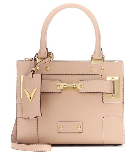 Day Bag Of The Month Valentino by Shows Arms In Jumpsuit As She Treats