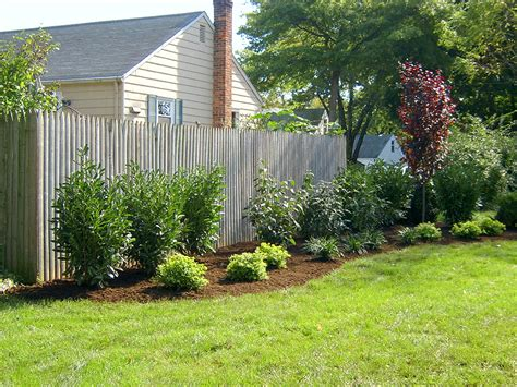 backyard landscaping ideas along fence charming popular of fenced backyard landscaping ideas easy garden ideas also