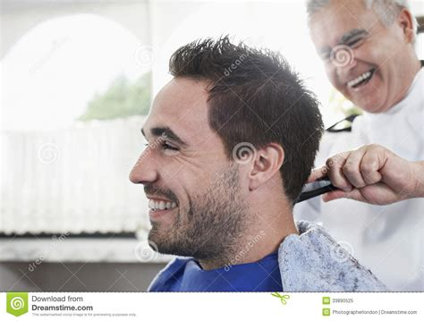 man getting an haircut from barber royalty free stock