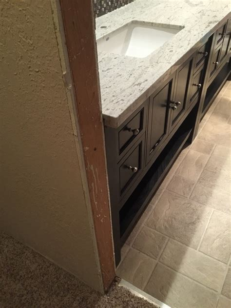 granite countertops installed with much overhang