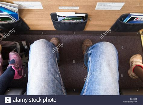 bulkhead seats in airplane passenger s legs shown while sitting in an airbus a319
