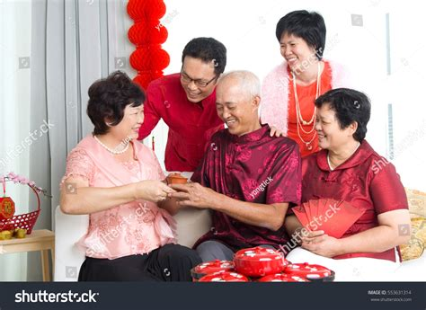 family celebrates with new years asian family celebrate new year stock photo