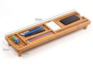 Desk Organizer Shelf The Bamboo Keyboard Shelf Boasts Integrated Desk Organizer Gadgetsin