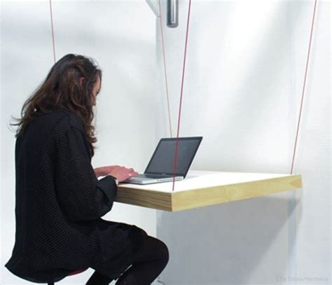 how to hang a on a table hang table a suspended desk that doubles as a hanger