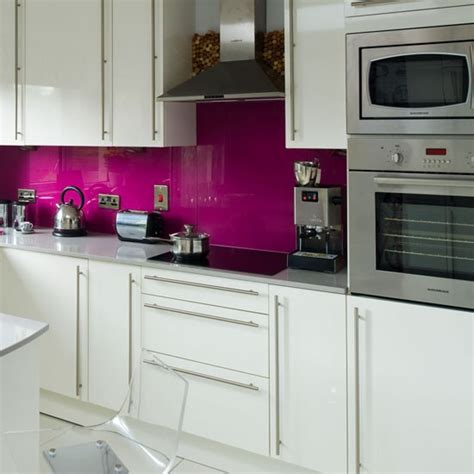 white kitchen with pink splashback colourful glass mosaics kitchen sourcebook