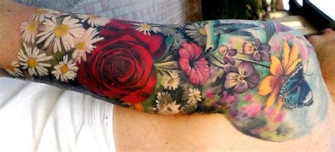 tattoo back spring spring flowers sleeve tattoo wrapping around arm cool