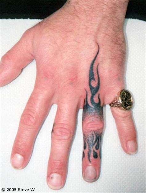 tribal finger tattoo black ink tribal finger