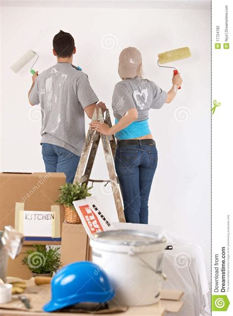 looking for a man who paints houses couple painting walls together stock photography image