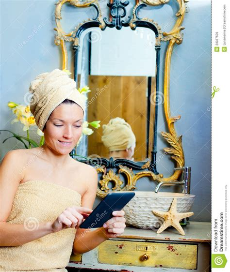 bathroom reading online female in bathroomreading ebook tablet royalty free stock