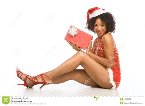 sexy ethnic woman in hat with christmas gift stock images