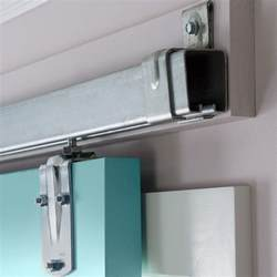 Sliding door hardware on a ledger board
