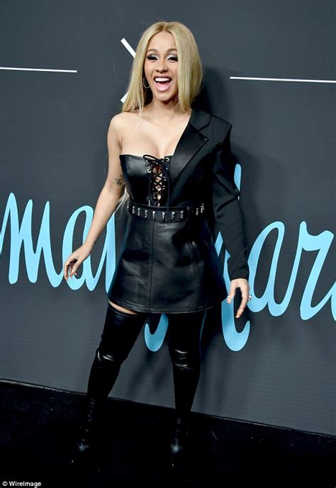 Cardi Black cardi b rocks black leather ensemble and hair