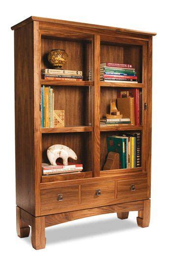 swinging bookcase sliding doors bookcases and woodworking on pinterest