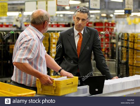Dhl Background Check Deutsche Post And Dhl Ceo Frank Appel Checks Out The Letter Assorting Stock Photo