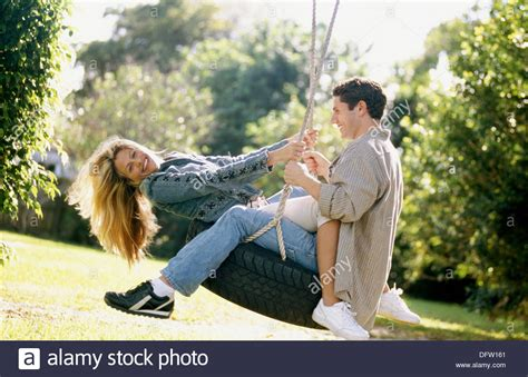 couples swing on a tire swing stock photo 61400697 alamy