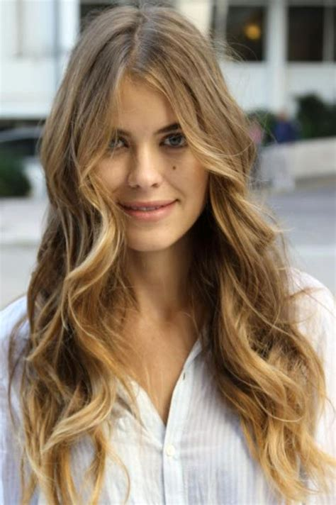 long layered hsir with waves around face the best wash and wear cuts for wavy hair beautyeditor