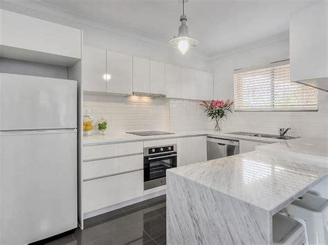 white kitchen gray floor kitchen and decor