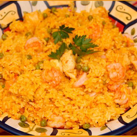 come cucinare la paella di pesce come preparare la paella al forno microonde paella