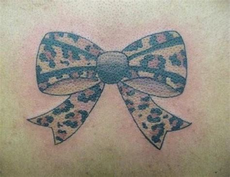 leopard print bow tattoo designs 30 cheetah print ideas hative