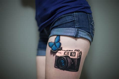 3d tattoo thigh 3d butterfly and canon camera tattoo on thigh