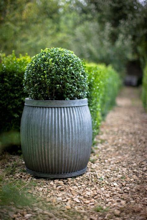 Zinc Planters by 10 Easy Pieces Zinc Barrel Planters Gardenista