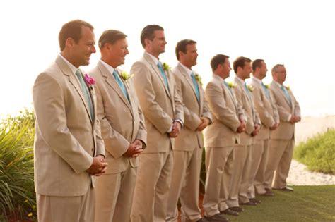 tan groomsmen suit   The Destination Wedding Blog   Jet