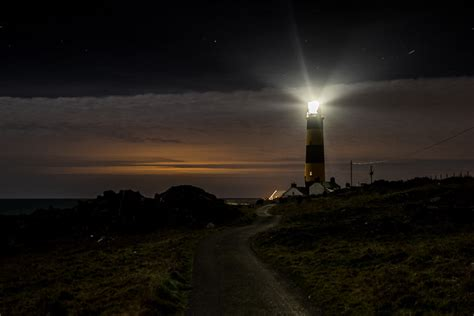 light house at night lighthouse at night pictures to pin on pinterest thepinsta