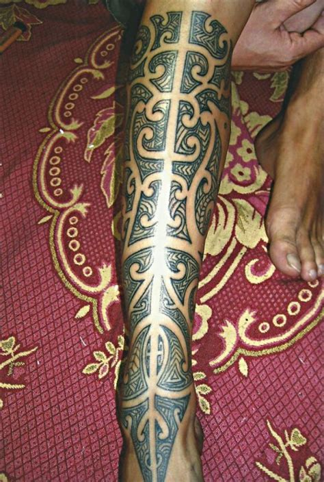 full leg tribal with a nice dolphin big magic tattoo