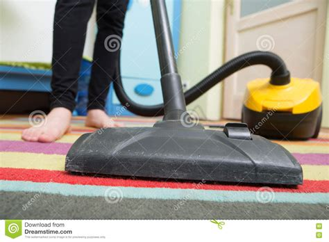 Hoovering The Floor by Cleaning Floor With Hoover Stock Photo Image 70183707