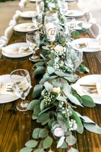 country table centerpieces feasting table with garland greenery centerpieces and