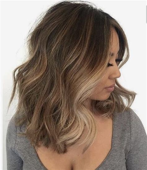 medium length highlighted hairstyles brown hair with blonde highlights short medium wavy