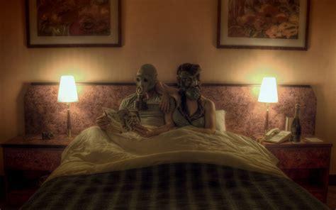 photo manipulation couple gas masks reading  bed