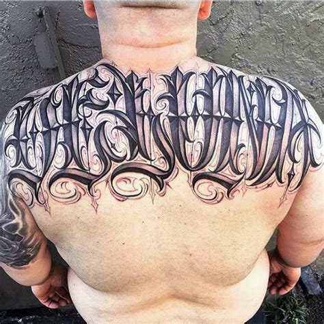 tattoo back lettering 75 tattoo lettering designs for men manly inscribed ink