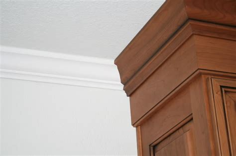 Two types of crown moldings in kitchen great room