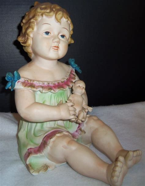 bisque piano doll antique german bisque porcelain piano baby holding