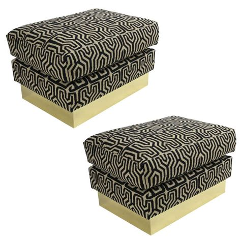 tribal ottoman pair of tribal upholstery ottomans with brass bases at 1stdibs