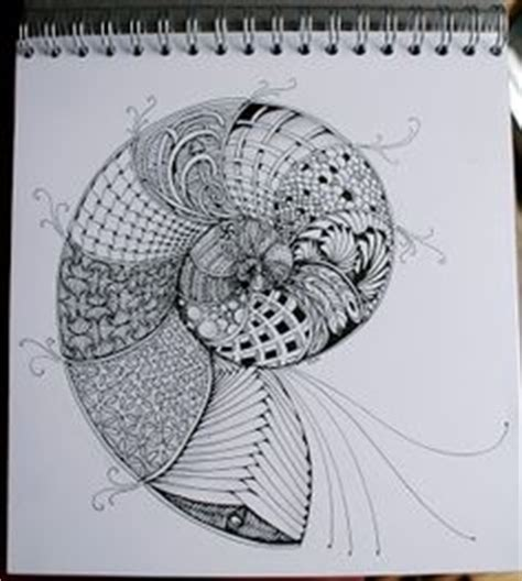 doodle snails meaning white ink on wildlife wood