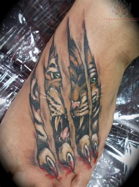 lion paw tattoo torn ripped skin paw big cat paws