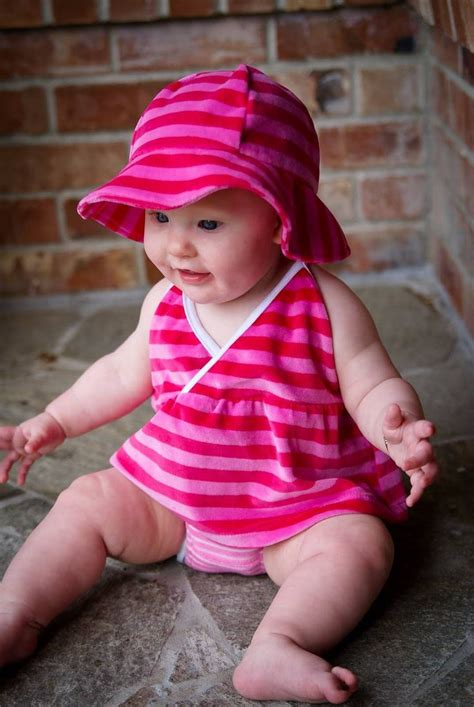 Baby Pink Bb baby wearing pink dress and blue 314x470