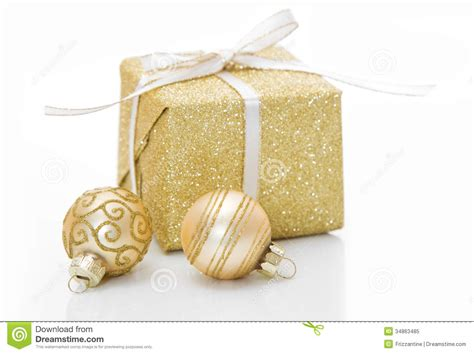 gold christmas gift box  bauble decorations isolated  whit royalty  stock photo