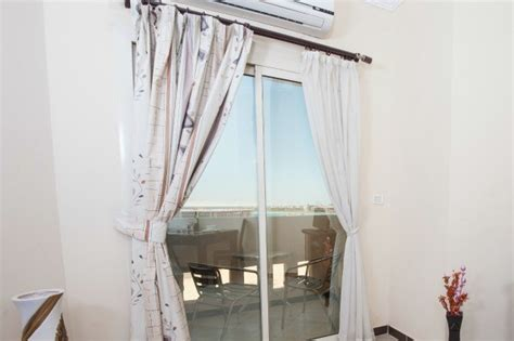 curtains over sliding glass door hanging curtains over a sliding glass door thriftyfun