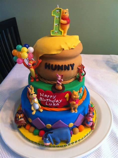 winnie the pooh birthday cake although the toys
